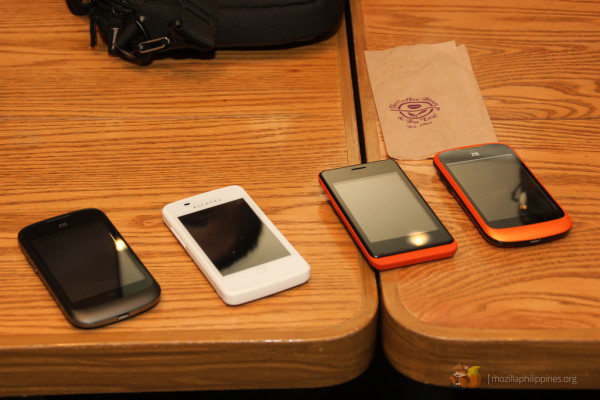 Devices running on Firefox OS: [L-R] ZTE Open, Alcatel OneTouch Fire, Geeksphone Keon, and a ZTE Open (eBay exclusive orange color).